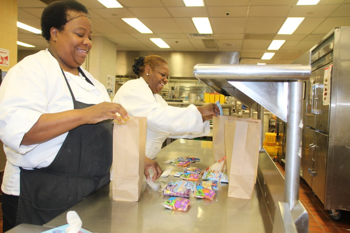 School food service professionals prepare meals for students