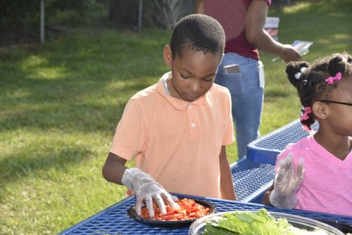 Orlando Health staff members volunteer at Orange Center Elementary School's Healthy Living Garden