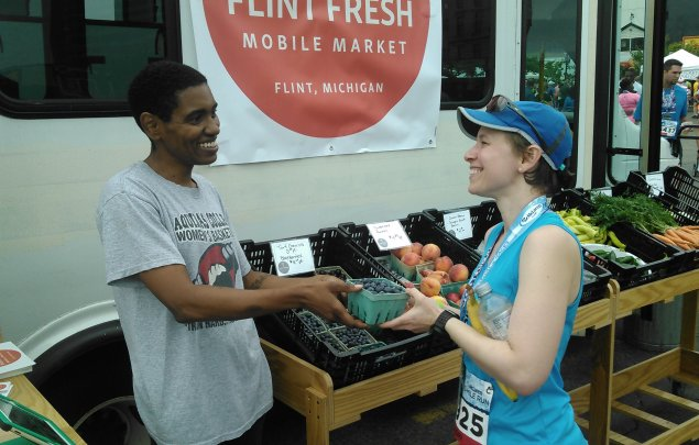 Flint Fresh Mobile Market, purchasing blue berries