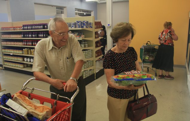Members shop for groceries